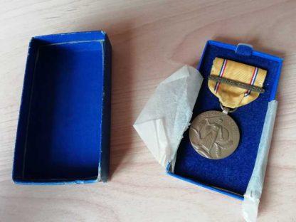 Médaille AMERICAN DEFENSE neuve originale en boite